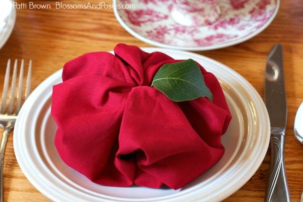 Use this apple napkin fold for an autumn tea party place setting!