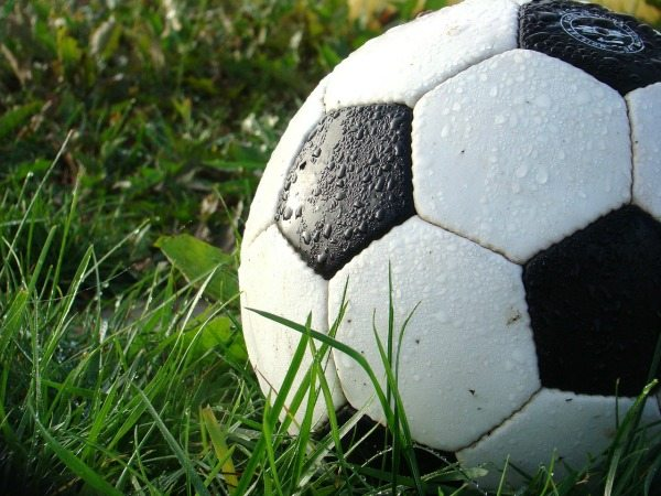 Play soccer outdoors with your kids