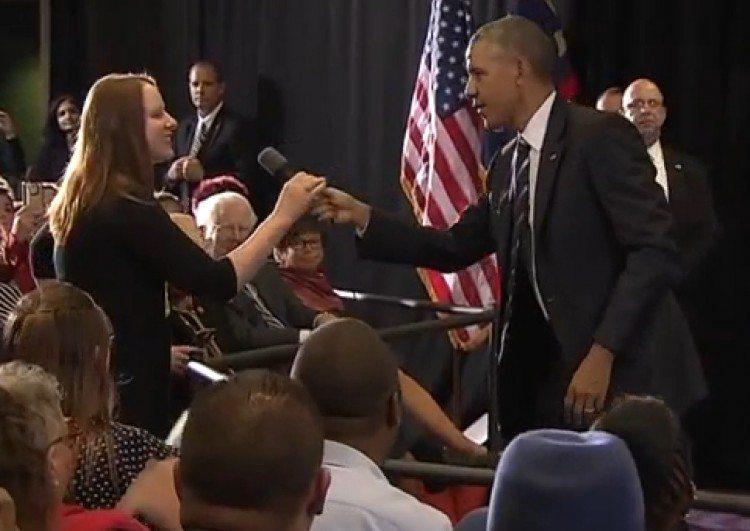 President Obama hands Erin mic