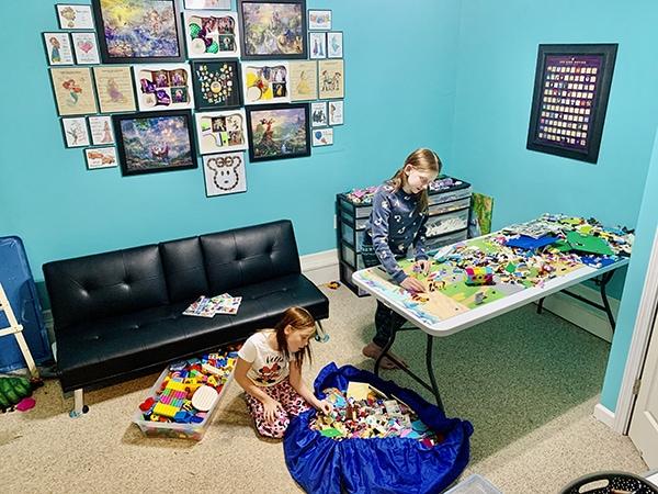 easy ways to organize LEGO - girls at LEGO table