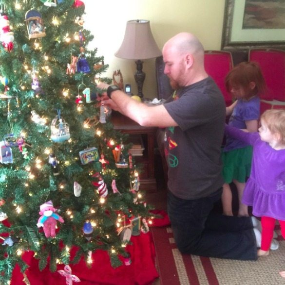 gift presence by decorating the Christmas tree