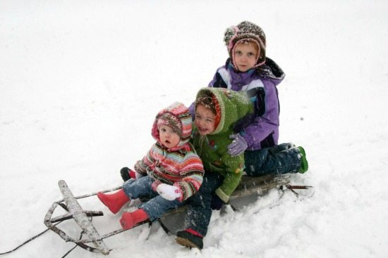 My 3 girls sledding in the snow!